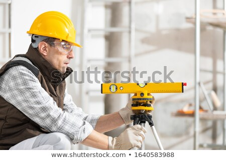 Workman with a spirit level Stock photo © photography33