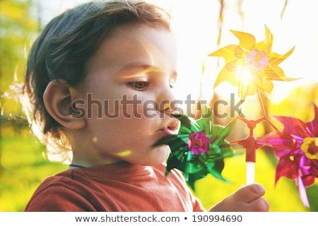 vicces · aranyos · boldog · baba · játszik · játszótér - stock fotó © konradbak