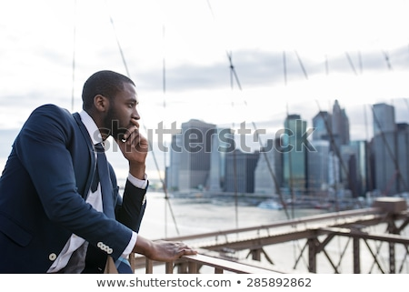 Portrait young black business man Stock photo © ivonnewierink