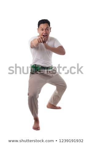 Asian man kungfu fighting Stock photo © szefei