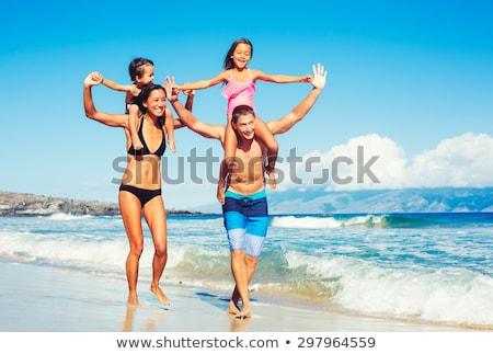 Fiúk jókedv játszik háton óceán jóképű Stock fotó © meinzahn