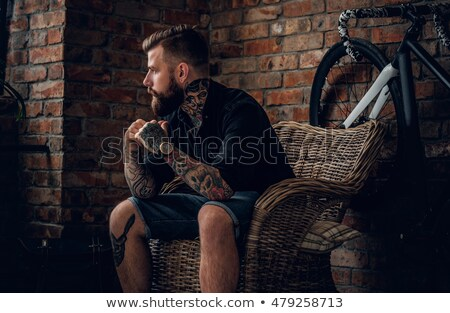 bearded man relaxes in studio Stock photo © feedough