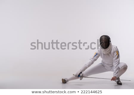 Stock photo: Female fencer looking excited