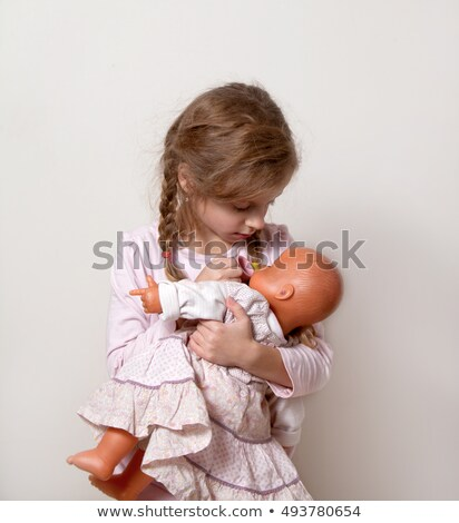 Sad girl holding stuffed toy at home Stock photo © mlyman