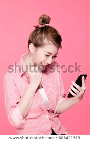 Happy woman holding pink camera on white background stock photo © id7100