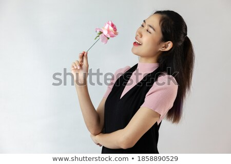 young asian cute woman smelling white flowers stock photo © witthaya