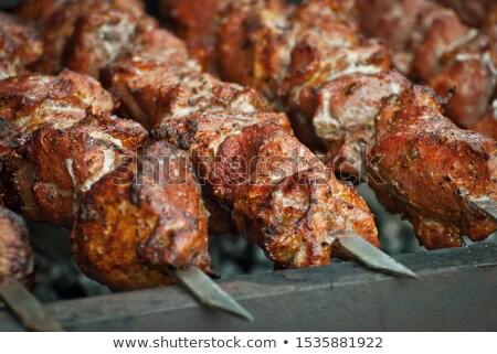 Fried meat shashlik barbecue on coals Stock photo © mcherevan