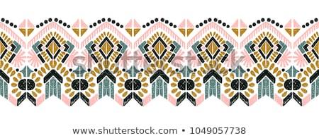 Seamless geometric ethnic pattern Stock photo © balasoiu