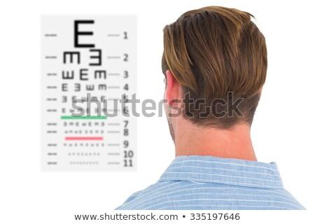 Centrado hombre traje examen de la vista cartas blanco Foto stock © wavebreak_media