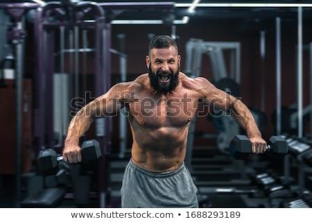 Dopasować człowiek ciężki hantle biały Zdjęcia stock © wavebreak_media
