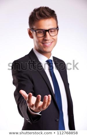 Stock photo: Business man holding something