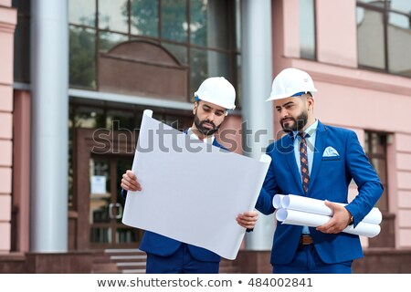 team of architects going over blueprints stock photo © wavebreak_media