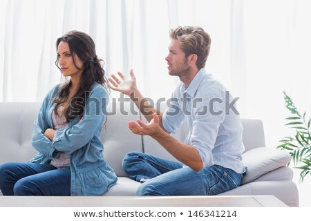 Outraged brunette woman with arms crossed Stock photo © wavebreak_media