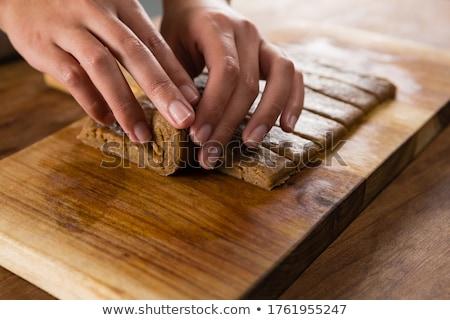 Woman arranging dough on chopping board Stock photo © wavebreak_media