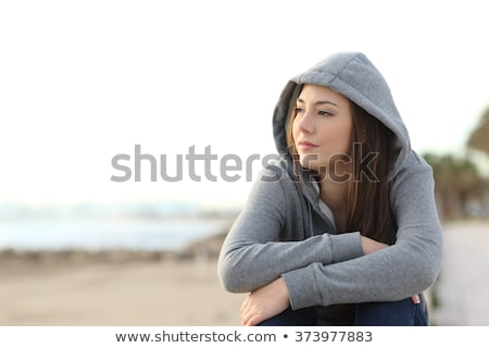 teenage girl looking out to sea stock photo © is2