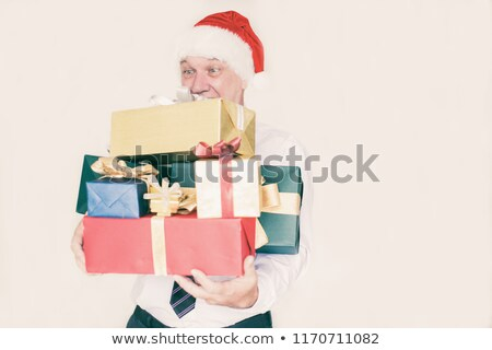 Mature man offers present to partner. Stock photo © IS2