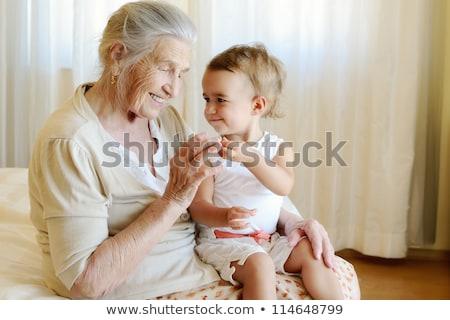 Supérieurs femme bébé petit-fils rouge canapé Photo stock © IS2