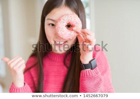 肖像 幸せ 若い女性 ドーナツ 顔 ストックフォト © deandrobot
