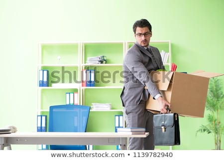 Male employee collecting his stuff after redundancy Stock photo © Elnur