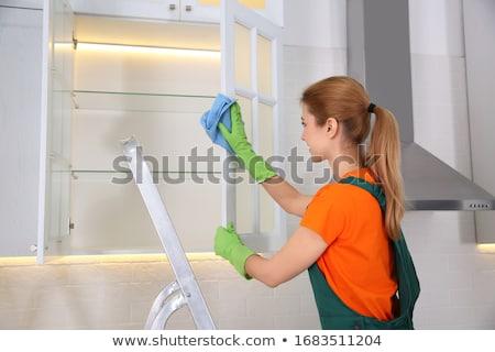 Feminino limpeza prateleira guardanapo sorridente Foto stock © AndreyPopov