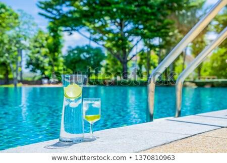 Gözlük su limon kavanoz kenar yüzme havuzu Stok fotoğraf © dashapetrenko