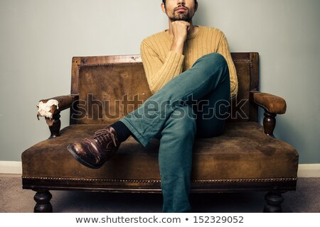 Anonymous man sitting on sofa and thinking. Stock photo © lichtmeister