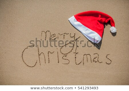 inscription on the wet sand and cap of Santa Claus Stock photo © galitskaya