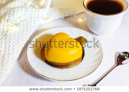 mini mousse cake with chocolate with cups of tea stock photo © illia