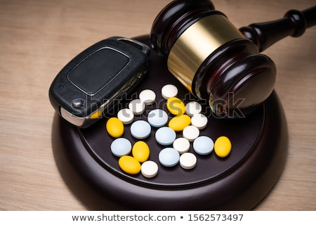 Pills, Car Key And Judge Gavel Over Desk Stock photo © AndreyPopov