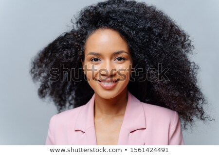 Close up portrait of beutiful happy curly haired prosperous business lady dressed formally, has curl Stock photo © vkstudio