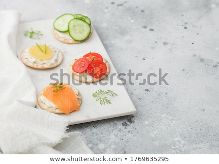 Különböző egészséges lazac sajt paradicsom uborka Stock fotó © DenisMArt