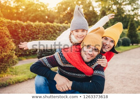 Handsome young man spends his free time with family, recieves em Stock photo © vkstudio