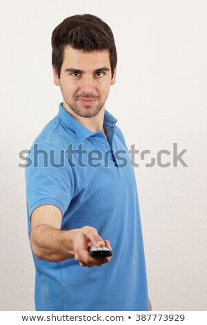 Men with the remote control, front of the television. Stock photo © justinb