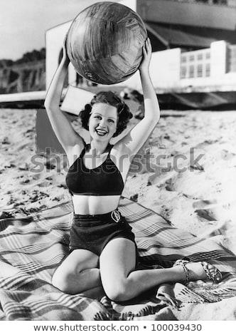 Femme ballon de plage séduisant maillot de bain Photo stock © iofoto