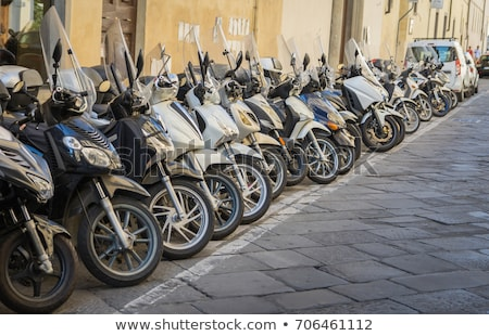 Row of motorbikes and scooters parked in Rome Stock photo © lightpoet