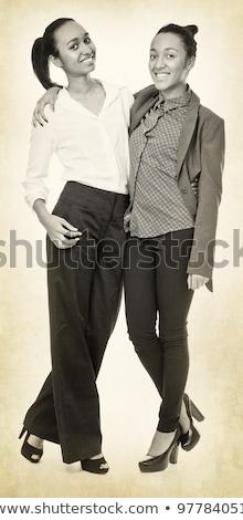 Lány amerikai 60-as évek stílus pötty ruha Stock fotó © fanfo