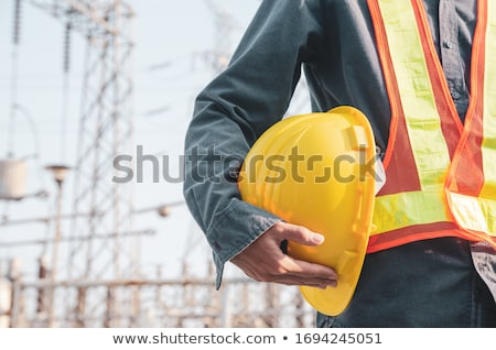 Workers holding hard hat Stock photo © photography33