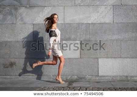 Nő árnyék gránit fal naplemente készít Stock fotó © smithore