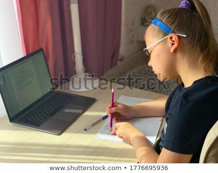 cute brunette schoolgirl does lessons  Stock photo © OleksandrO