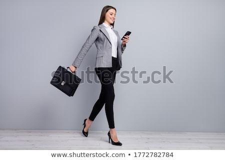 Perfil mujer de negocios sonriendo maleta café Foto stock © wavebreak_media