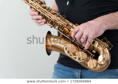 Close-up of man holding saxophone Stock photo © zzve