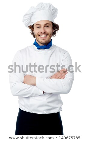 Confident young cook posing in uniform Stock photo © stockyimages