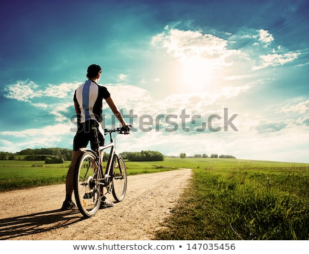 man on bike in the green field Stock photo © chesterf