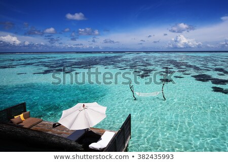 puesta · de · sol · vacaciones · playa · rayos · de · sol · lujoso · alquilar - foto stock © joningall