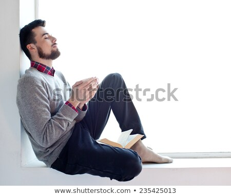 bearded young man in thinking position Stock photo © feedough