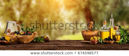 Fles olijfolie oude tabel houten tafel achtergrond Stockfoto © marimorena
