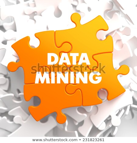 data mining on yellow puzzle stock photo © tashatuvango
