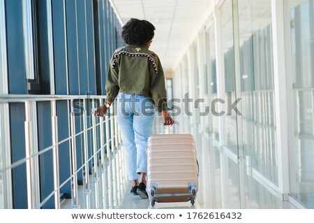 Portrait of traveling family in airport Stock photo © dashapetrenko