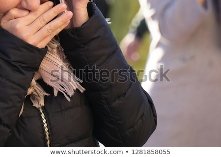Girl whispering  into cellphone. Stock photo © iofoto