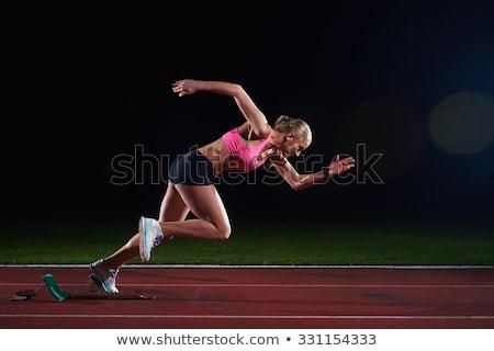 woman  sprinter leaving starting blocks Stock photo © dotshock